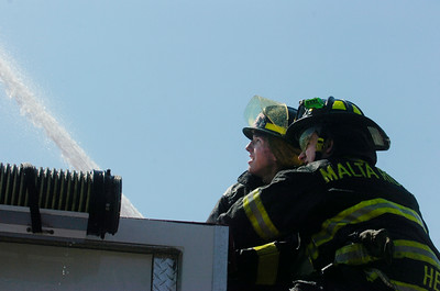 """Members of volunteer fire departments at Malta Ridge spray their water during the """"wet down"""" ceremony held by neighboring fire departments during it's initiation of the new Milton FD tank truck into the fire company.  Photo Erica Miller 4/29/12 news_MiltonFD5_Mon"""