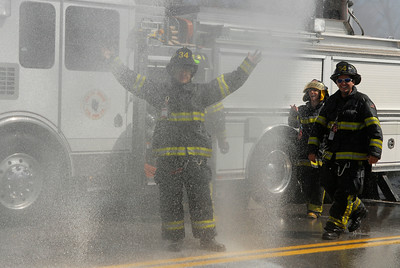 """From the Malta Ridge Fire Department John Manesis embraces the cold water during the """"wet down"""" ceremony held by neighboring fire departments during it's initiation of the new Milton FD tank truck into the fire company.  Photo Erica Miller 4/29/12 news_MiltonFD3_Mon"""