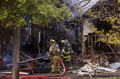 Fire Departments from Milton, Greenfield, Rock City Falls work on a structure fire on Route 29 mid-afternoon on Monday. The residents of the home were safely evacuated. Photo Erica Miller 4/30/12 news_Fire6_Tues
