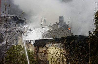 Fire Departments from Milton, Greenfield, Rock City Falls work on a structure fire on Route 29 mid-afternoon on Monday. The residents of the home were safely evacuated. Photo Erica Miller 4/30/12 news_Fire1_Tues