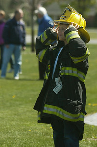 """Wearing his Captain Ballston Spa Union fathers jacket Steven Bowers smiles as the fire trucks get ready to line up during the """"wet down"""" ceremony held by neighboring fire departments during it's initiation of the new Milton FD tank truck into the fire company.  Photo Erica Miller 4/29/12 news_MiltonFD6_Mon"""
