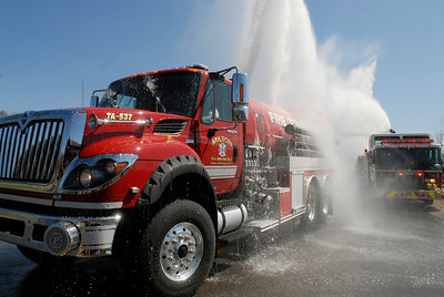 """The new Milton Fire Department tank truck drives through the """"wet down"""" from neighboring fire departments during it's initiation into the fire company.  Photo Erica Miller 4/29/12 news_MiltonFD1_Mon"""