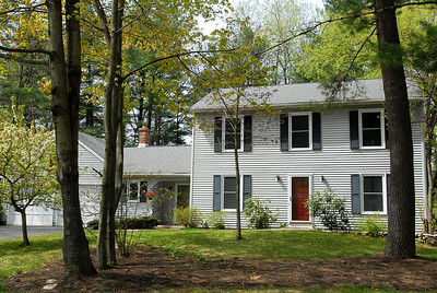 This house at 18 Woodlake Drive, Wilton, recently sold for $250,000. Photo Erica Miller 4/30/12 0505_Transaction