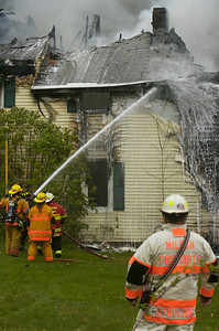 Fire Departments from Milton, Greenfield, Rock City Falls work on a structure fire on Route 29 mid-afternoon on Monday. The residents of the home were safely evacuated. Photo Erica Miller 4/30/12 news_Fire3_Tues