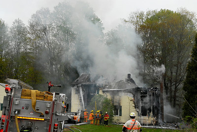 Fire Departments from Milton, Greenfield, Rock City Falls work on a structure fire on Route 29 mid-afternoon on Monday. The residents of the home were safely evacuated. Photo Erica Miller 4/30/12 news_Fire4_Tues