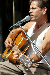 "During any given good weathered day, John Bagnoli,  a troubadour, performs for a couple of hours in front of Smokin' Sam's Cigar Shop on Caroline Street. Bagnoli plays music from the 50's and on, and said that ""Neil Diamond sounds a lot like me."" Photo Erica Miller 8/28/09 news_Bagnoli1_Sat"