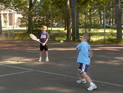 Brandon Aschauer, age 9, looks on as his seven year old brother Justin returns a serve during a tennis lesson given by their grandmother Thursday on the asphalt tennis courts in Saratoga Spa State Park. The brothers are from Schuylerville. Ed Burke 8/27/09