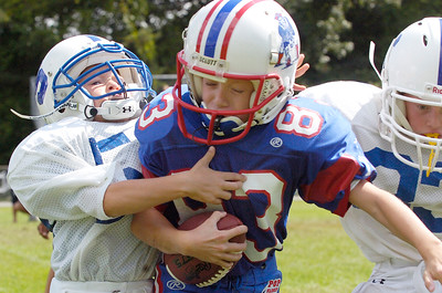 Grayson Dumortier, Saratoga, tackles down Thomas Weisenforth, Troy Patriots, during their Might Mites scrummage game at the East Side Rec Sunday morning. Photo Erica Miller 8/30/09 spt_PopWarner3_Mon