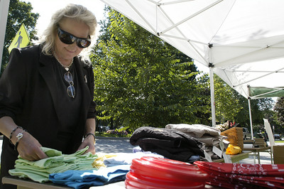 Sue Panz, an employee for the NYS Racing Museum, straightens up some of the shirts for the sale at the Huge Tent Sale outside of the Museum Sunday afternoon. The Huge Tent Sale continues until Labor Day. Photo Erica Miller 8/30/09 news_HugeTent_Mon