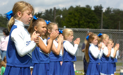 The Saratoga Pop Warner Cheerleaders encourage their football players during their game against the Troy Patriots for the 7,8,9 year old Might Mites game Sunday morning at the East Side Rec. Photo Erica Miller 8/30/09 spt_PopWarner6_Mon