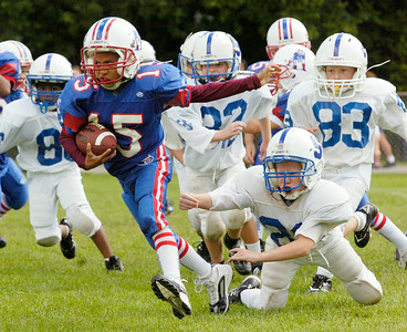 Devionaire Holmes, Troy Patriots, runs down the field with the ball during their scrimmage game against Saratoga for the 7,8,9 year old Might Mites game Sunday morning at the East Side Rec. Photo Erica Miller 8/30/09 spt_PopWarner1_Mon
