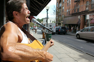 "During any given good weathered day, John Bagnoli,  a troubadour, performs for a couple of hours in front of Smokin' Sam's Cigar Shop on Caroline Street. Bagnoli plays music from the 50's and on, and said that ""Neil Diamond sounds a lot like me."" Photo Erica Miller 8/28/09 news_Bagnoli2_Sat"