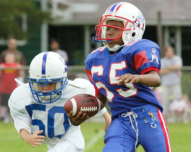 Zarek Thomas, Troy Patriots, runs down the field with the ball as Grayson Dumortier, Saratoga, runs behind to tackle him during their Might Mites scrummage game at the East Side Rec Sunday morning. Photo Erica Miller 8/30/09 spt_PopWarner2_Mon