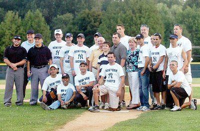 Jockey softball team before the start of their game against Media at the East Side Rec where proceeds raised funded the Disabled Jockey Foundation. Photo Erica Miller 8/30/10 news_Softball1_Tues