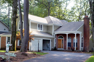 This house at 28 Hearthstone Drive, Wilton, recently sold to Paul W and Martha C. Ackmann for $419,900. Photo Erica Miller 8/31/10 0904_Transactions