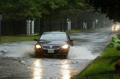 Cars make their way down flooded Union Ave just in front of the Saratoga Race Course main entrance as Tropical Storm Irene hits Saratoga Springs Sunday afternoon. Photo Erica Miller 8/28/11 TropicalStorm8