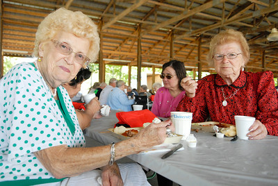 Milton residents Mary Devin (left) and Elsie Gates at the Saratoga County Annual Senior Picnic was held at the Saratoga County Fairgrounds this afternoon, as hundreds enjoyed free lunch. Photo Erica Miller 8/30/11 fea_SeniorPicnic3
