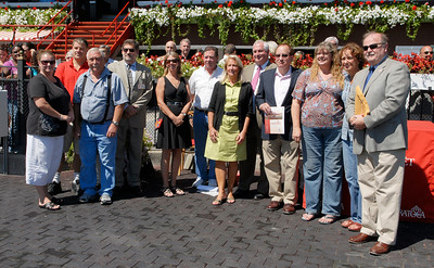 Members and volunteers from NY Chaplaincy, EOC and B.E.S.T. collected at the winners circle for the first race, as it marked Backstretch Volunteer Appreciation Day at the Saratoga Race Course. Tuesday evening they will enjoy dinner at the backstretch for Sunday night dinner starting at 5:30. awards at 6. Photo Erica Miller 8/29/11 news_Appreciation_Tues