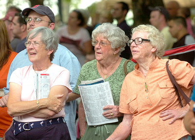 Albany residents Carolyn Gaynor, left, Mary Hogan, center, and Marge Grogan watch Saturday's Ballston Spa feature race on large monitor in the backyard area of the track. Ed Burke 8/27/11