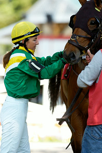 Steeplechase jockey Danielle Hodsdon helps saddle Memorial Maniac for the first race on Thursday at the Saratoga Race Course, on Thursday they announced that the Steeplechase Festival was canceled. Photo Erica Miller 8/30/12 news_Canceled5_Sat