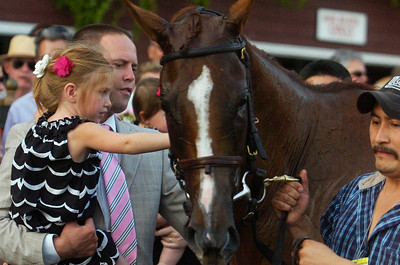 Trainer Chad Brown helps his daughter Ava pet Dayatthespa, a NY Bred, after they won the 4th Running of The Riskaverse at the Saratoga Race Course on Friday evening. Photo Erica Miller 8/31/12 spt_Riskaverse3_Sat