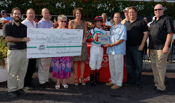 "Check Presentation where NRYA made at $5,000 donation to assist with rebuilding efforts during a ceremony in the winner's circle following the day's fourth raceme which was named ""Remembering Irene & Lee - The Recovery Continues."" Photo Erica Miller 8/30/12 news_Remembering1_Sat"