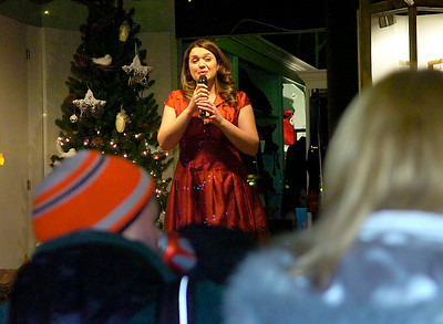 Soprano Holly McCormack performs Ave Maria in the window of Lifestyles on Broadway during First Night festivities. Ed Burke 12/31/09