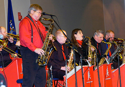 Joey Thomas, left, and his big band perform at the City Center Thursday night during First Night. Ed Burke 12/31/09