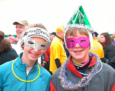 Visiting from California, twelve year old Dylan Lynch, left, prepares to run in the First Night 5K with her cousin Max Lynch, also twelve, of Saratoga Springs. Ed Burke 12/31/09