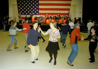Couples dance to the sounds of the Joey Thomas Big Band during First Night festivities at the City Center. Ed Burke 12/31/09