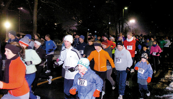 Runners leave the start of Thursday's First Night 5K run at Skidmore College. 1000 runners took part in the event. Ed Burke 12/32/09