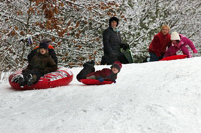 Shea Weilbaker (front left), 9 of Wilton, and teammate rider Zack O'Connor, 9 of Greenfield, slide down the hill along with Jackson Taunton, 7 from Georgia (right), at the McGregor Links Golf Course hill in Wilton after a fresh snow fall Monday morning. Photo Erica Miller 12/28/09 wg_SledSnow1