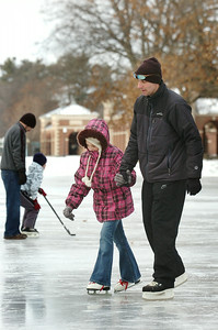 Maddi Kieft, 8 years old, holds the hand of her uncle Bruce Kieft, of Middle Grove, as they practice their ice skating at the Saratoga Spa Park near the Victorian Pool on Wednesday morning. Photo Erica Miller 12/30/09 news_SkatingSkills_Thurs