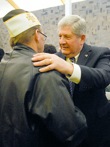 Senator Roy McDonald gives a hug to Veteran Thomas Doin after his swearing-in ceremony Wednesday afternoon at the TEC-SMART campus, through Hudson Valley Community College. Photo Erica Miller 12/29/10 news_McDonald4_Thurs