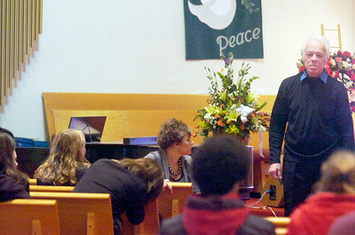 Inside the Presbyterian New England Congregational Church during calling hours, grandfather Oleg Moston of 12 year old Nicholas Naumkin, Nicholas was shot and killed by a friend playing with a handgun merely two days before Christmas. Moston played the piano during some of the hours. Photo Erica Miller 12/27/10 news_CallingHr5_Tues