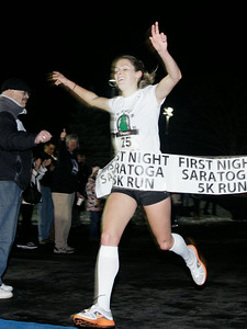 Nicole Blood of saratoga Springs finishes first of the female runners. Ed Burke 12/31/10