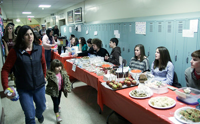 Members of the Saratoga Springs High School Latin Club work their bake sale at Lake Ave. Elementary School during First Night. The club was raising funds for their trip to the Metropolitan Museum of Art in New York City and also for the David Taylor Miller Scholarship Fund. Ed Burke 12/31/10