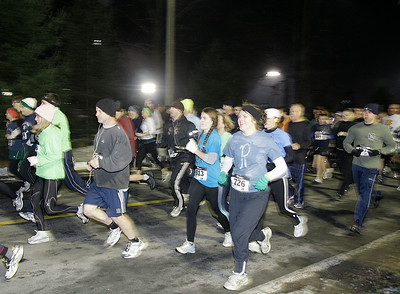 Runners competing in the 2011 First Night 5K run leave Skidmore College to begin their race. Ed Burke 12/31/10