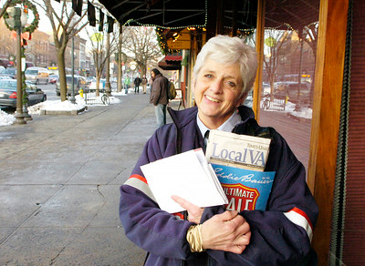 "Ready to retire, Lettercarrier Michele Keller flashes a smile on her last day of work delivering mail on Broadway Thursday after 26 years with the U.S. Postal Service. ""I've met so many wonderful people"" said Keller before pausing to pet a passing pooch, adding ""and puppies."" Ed Burke 12/30/10"