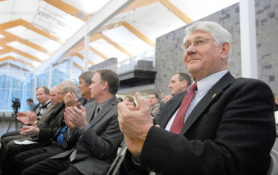 Jim Fischer applauded during Senator Roy McDonald's speech during his swearing-in ceremony Wednesday afternoon at the TEC-SMART campus, through Hudson Valley Community College. Photo Erica Miller 12/29/10 news_McDonald2_Thurs