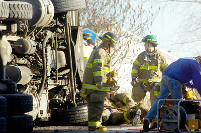 Wilton Fire Department on scene for a accident occurring on Ballard Road and intersection of Northern Pines Road, in Wilton, involving a garbage truck and a dump truck shortly after 1:00. Photo Erica Miller 12/28/10 news_Accident1_Wed