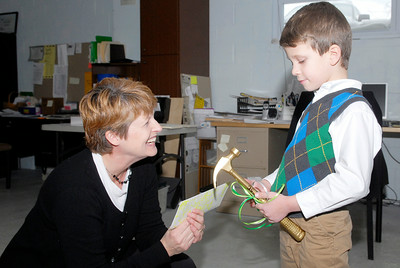 While celebrating his 6th birthday party, Owen Yonkin, 6 years old of Saratoga Springs, asked his friends to donate money. Owen collected $250 to donate to Rebuilding Together Saratoga, which he donated Monday morning to Michelle Larkin and received a golden hammer and tee-shirt.Photo Erica Miller 12/27/10 news_Donates1_Tues