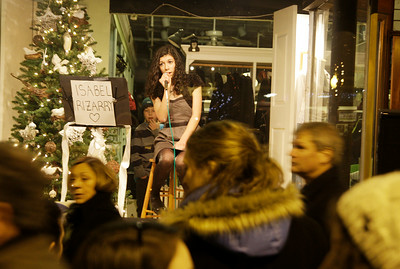 Singer Isabel Irizarry, age 14, performs in the window of Lifestyles on Broadway. Ed Burke 12/31/10