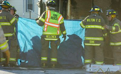 Silhouettes of firefighters and Wilton EMS as they evacuate the a person from the garbage truck on scene for a accident occurring on Ballard Road and intersection of Northern Pines Road, in Wilton. Photo Erica Miller 12/28/10 news_Accident3_Wed