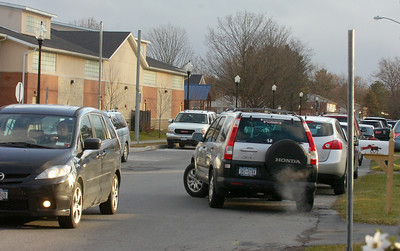 Cars weave around each other Wednesday along Vanderbilt Ave. near the Saratoga Springs Recreation Center. A signpost with out a sign has been installed by the city at right. The youth center was hosting the Snowball Shootout Basketball Tournament on Wednesday. Ed Burke 12/28/11