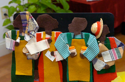 Fabric figurines handmade by an artist were given to Francelise Dawkins over 25 years ago. Creativity is one of the seven principals of Kwanzaa and the sharing handmade gifts or preparing a gift of a meal is symbolic to the meaning of Kwanzaa. Ed Burke 12/30/11