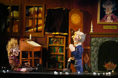 Ebenezer Scrooge kneels on a knee as he offers his co-worker Bob Crantchit a raise the day after Christmas during A Christmas Carol presentation by The Puppet People, based out of Schenectady, for audiences at the Saratoga Springs Public Library. Photo Erica Miller 12/29/11 news_Puppets6_Fri