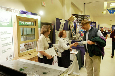 Linda Fox, left and Sharron-Linn Schmidt  of Rotterdam-based Huff 'N' Puff talk with prospective customers Saturday at the Saratoga Rotary Club's Home and Garden Show at the city center. The company specializes in gutter systems and Andersen windows. Ed Burke 2/28/10