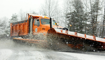 A city DPW snow plow clears the street of Crescent Ave Tuesday afternoon during the heavy snowfall of the day, which may lead to school cancelations Wednesday morning. Photo Erica Miller 2/23/10 news_SnowFall1_Wed