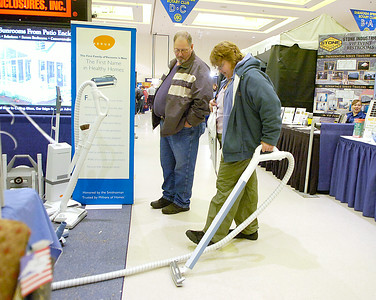 Cindy Chard and John Brown of Fort Edward test drive a vacuum cleaner offered by Aerus, formerly Electrolux, Saturday during the Saratoga Rotary Home and Garden Show at the city center. Ed Burke 2/28/10